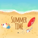 Summer time. Clothes on the beach. Sand grains. Waves from the sea. Surfboard. Footprints from the feet on the sand. Rest on the b Stock Photo