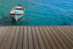 Summer time concept with docked boat Royalty Free Stock Images