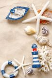 Summer time concept with sea shells and starfish on sand royalty free stock image