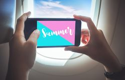 Summer time concepts with female taking a photo by smartphone on plane stock images