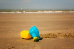 Summer time fun. Children beach toys on a beach in summer Belgian coast Stock Photography