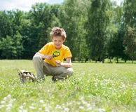Summer time. Happy boy with magnifying glass outdoors. Stock Photo