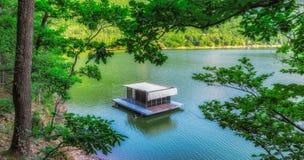 Pontoon on a mountain lake. Summer-time house on a mountain lake royalty free stock photos