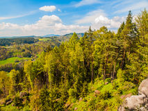 Summer time landscape with green forest, sandstone rocks and blue sky with white clouds, Bohemian Paradise, aka Cesky Stock Photography