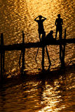 Summer Time, life, river. Silhouette photo of children on the wood bridge before sunset Royalty Free Stock Photography