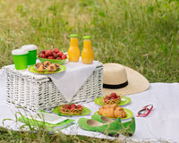 Summer time: picnic on the grass - coffee and croissants, juice. And berries. Selective focus royalty free stock photos
