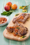 Summer Time Pork Chops. Grilled pork chops with nectarine - pepper chutney. Fresh nectarines and hot pepper Stock Photography