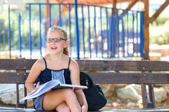 Summer Time Relaxing - Little Girl Reading Book Outdoor On Warm Day. stock photos