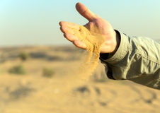 Summer time sand in hands Stock Images