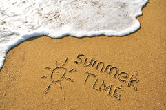 Summer time. Sign on the sand beach Royalty Free Stock Image