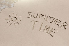 Summer time sign on the sand Stock Photo