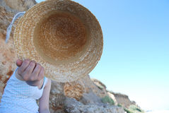 Summer time. Straw hat and a perfect sun for a perfect summer day Royalty Free Stock Photography