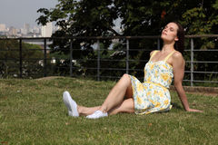 Summer time sun in city park for pretty woman Royalty Free Stock Image