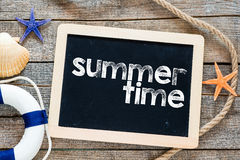 Summer time Text on blackboard Stock Image