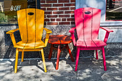 Summer time. Two chairs covered by shade on a side walk Stock Photography