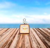 Summer Time, Vintage clock put on wooden with Blurred image. Of peaceful sea background royalty free stock images