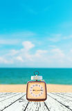 Summer Time, Vintage clock put on wooden with Blurred image Stock Photos