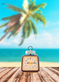 Summer Time, Vintage clock put on wooden. With Blurred image of peaceful sea background stock images