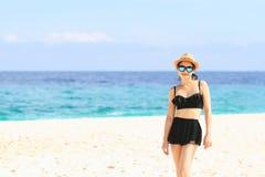 Summer time, woman in bikinis. Young beautiful woman on the beach. Young beautiful woman on the beach, Woman with sunglasses in bikinis royalty free stock photo