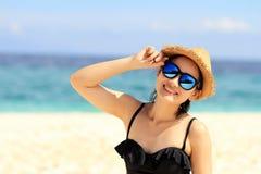 Summer time, woman in bikinis. Young beautiful woman on the beach. Young beautiful woman on the beach, Woman with sunglasses in bikini. Color Process royalty free stock photo