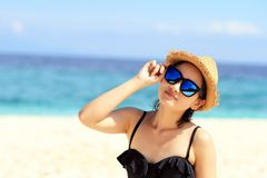 Summer time, woman in bikinis. Young beautiful woman on the beach. Young beautiful woman on the beach, Woman with sunglasses in bikini. Color Process royalty free stock photography