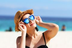 Summer time, woman in bikinis. Young beautiful woman on the beach. Young beautiful woman on the beach, Woman with sunglasses in bikini, Sunglasses reflects the stock photography
