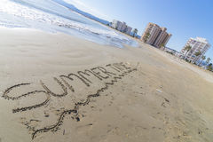 Summer time. Summer time written on the beach Stock Photography