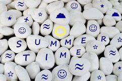 Summer time written on white stones Royalty Free Stock Photos