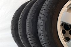 4 summer tires. Fragments of 4 modern new summer tires Royalty Free Stock Photo