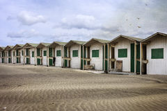 Summer is yet to come. Changing rooms at the beach stock images