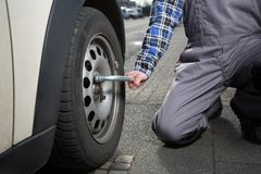Summer to winter tire change Royalty Free Stock Photos