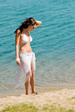 Summer toned woman walking beach in bikini Royalty Free Stock Images