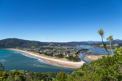 Summer top view on a seaside town. View on Tairua town from the top of Paku mountain, the Coromandel peninsula, New Zealand Stock Image