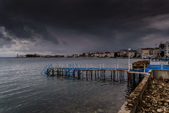 Summer Town In The Rain. A small but relatively popular summer town named Cinarcik located in Marmara region of the country Turkey experienced the most chilly Stock Photo