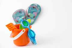Summer toys bucket with spade goggles flip flops  Royalty Free Stock Image