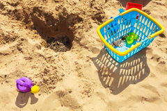 Summer toys lying on sand. Stock Images