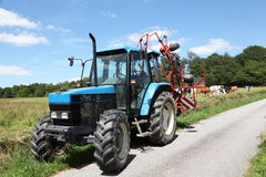 Summer Tractor And Hay Rake Royalty Free Stock Image