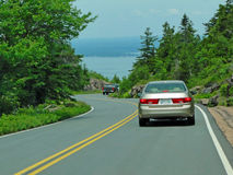 Summer traffic descending road. From summit of Mount Desert Island, Acadia National park, Maine, New England Royalty Free Stock Photo
