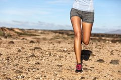 Summer trail running athlete woman runner legs. Summer trail running athlete runner legs lower body crop. Fitness woman jogging living an active lifestyle royalty free stock photography
