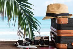 Free Summer Travel And Plan With Vintage Suitcase Luggage And Old Camera In The Sand Beach. Travel In The Holiday Trips, Airplane. Blu Stock Photo - 168213100