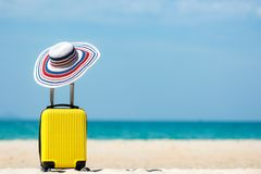 Free Summer Travel And Plan With Yellow Suitcase Luggage In The Sand Beach. Travel In The Holiday Trips, Airplane And Blue Sky Backgrou Royalty Free Stock Photo - 165557445