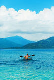 Summer Travel Kayaking. Man Canoeing Transparent Kayak In Ocean Stock Photography