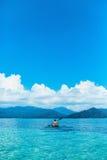 Summer Travel Kayaking. Man Canoeing Transparent Kayak In Ocean Royalty Free Stock Image
