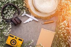 Summer travel object composition of headphone toy camera flowers royalty free stock photo