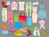 Summer travel packing for vacation. Woman clothing set. Vector hand drawn isolated objects. Colorful drawing fashion Royalty Free Stock Images