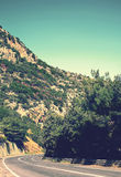 Summer travel photo of mountains and road Royalty Free Stock Image
