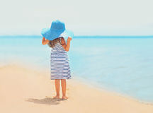 Summer travel photo pretty little girl in dress and straw hat Stock Images