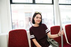 Summer Travel. Portrait Of Happy Smiling Girl In Stylish Sunglasses travelling by bus. Royalty Free Stock Photos
