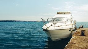 Summer Travel Vacation Adventure Concept. Cruise Yacht Moored To. Pier In Harbor with Copy Space. Gelendzhik, Russia royalty free stock photography