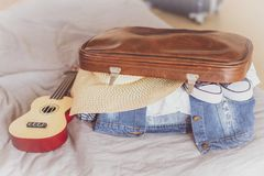 Summer travel and vacation concept,Young woman packing suitcase at home stock image